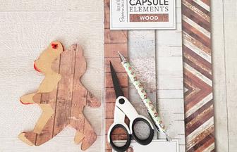 habiller l'ours en bois avec du papier