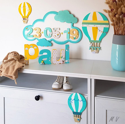 Tutoriel : une déco montgolfières avec des nuages en bois pour la chambre de bébé