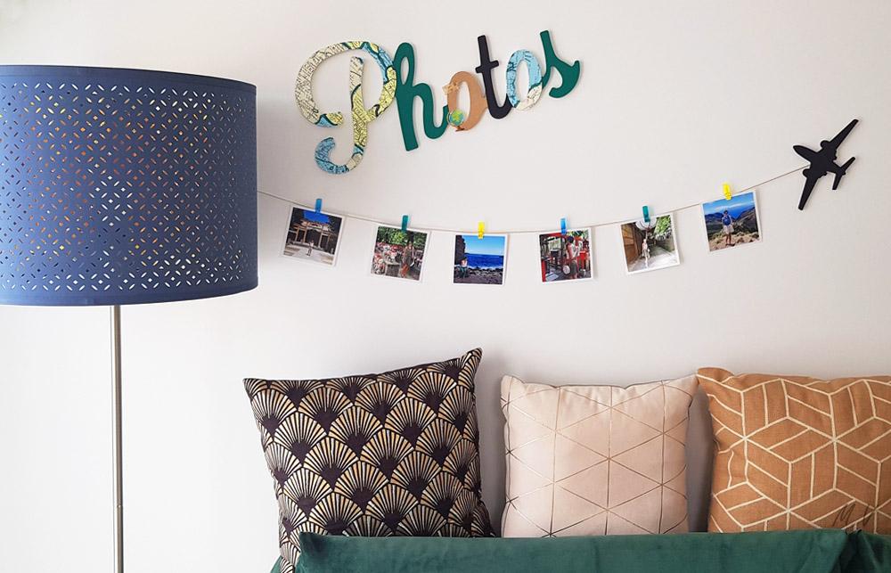 Une idée déco photo pour vos murs en bois avec vos souvenirs de voyages !