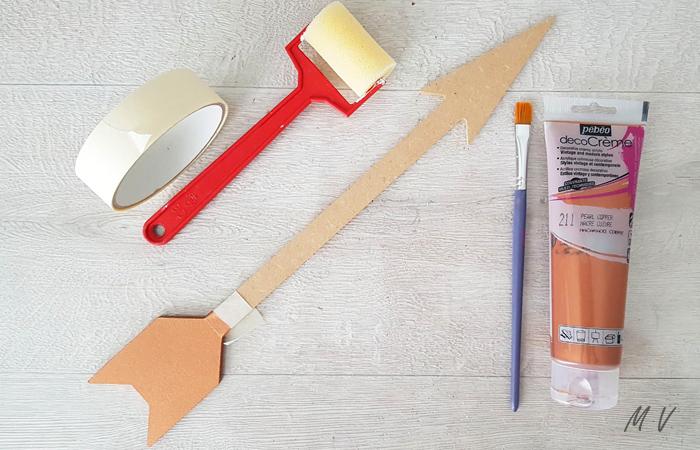peindre la flèche en bois en cuivre