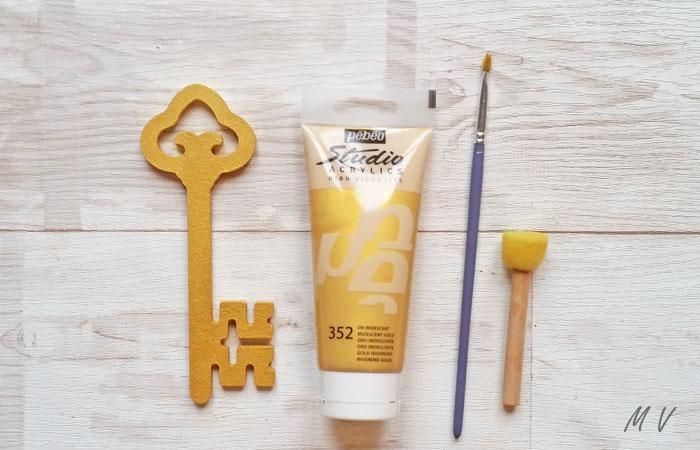 peindre al clé en bois en or